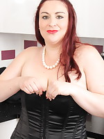 Chubby British housewife playing in her kitchen
